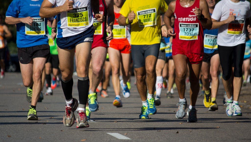 Group picture of runners legs in a race