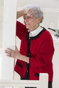 Senior woman appearing to have head pain or stroke