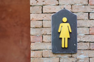 Woman's universal bathroom symbol - incontinence