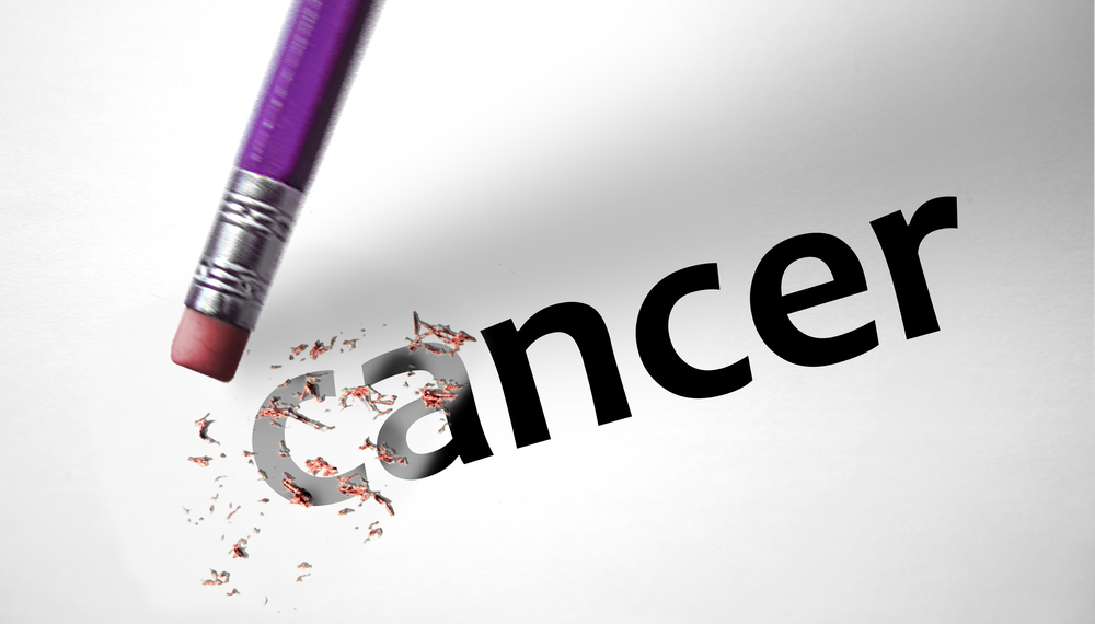 Pencil erasing the word cancer
