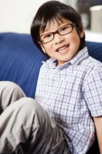 little Asian boy wearing glasses