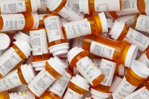 pile of prescription drug bottles