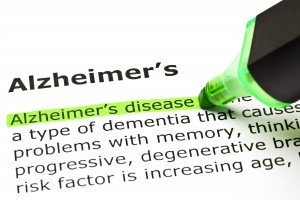 Alzheimer's disease definition highlighted in dictionary