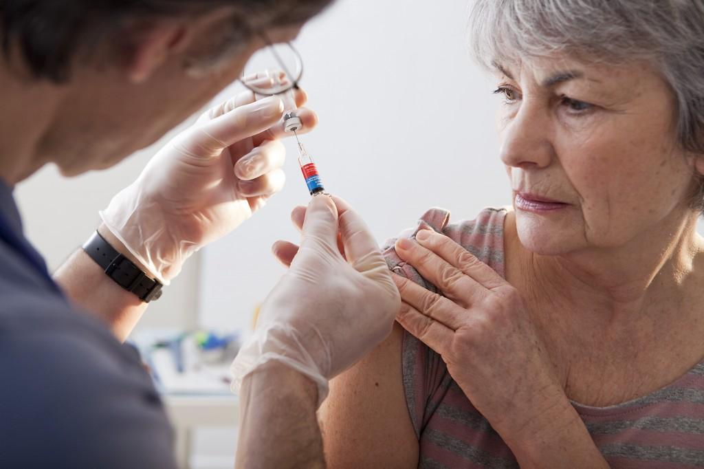 vaccinating an elderly woman - senior citizen