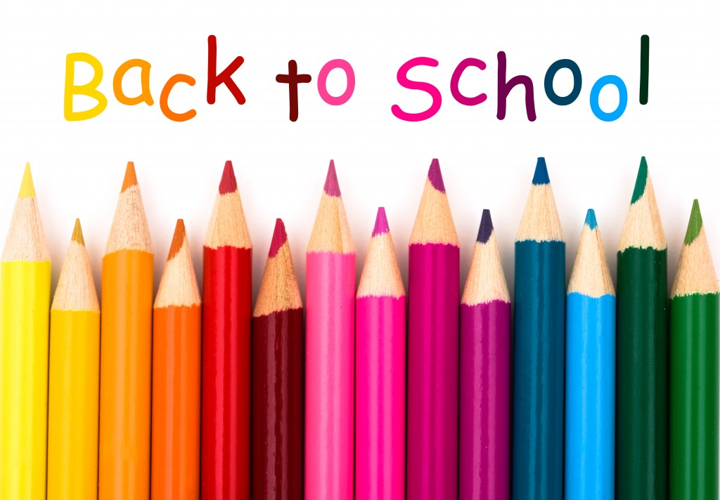 colorful pencil crayons on a white background spelling back to school