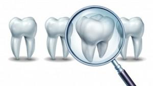 Ilustración de varios dientes y una lupa