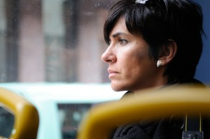 woman staring out a window deep in thought