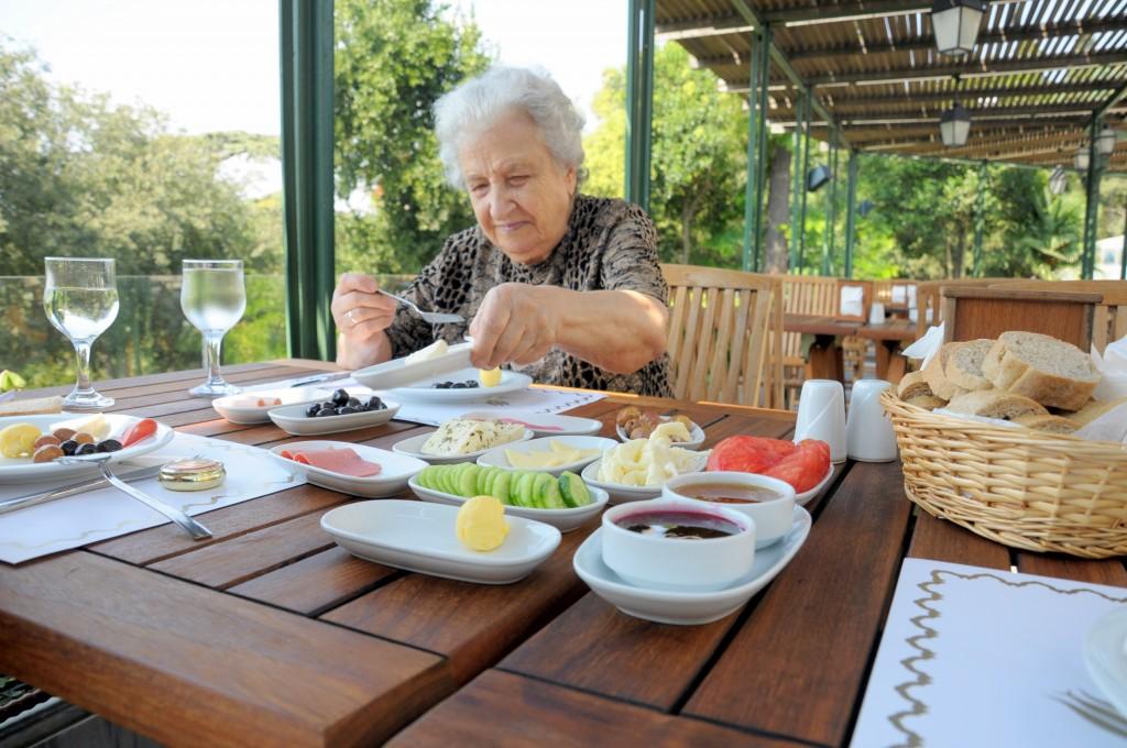 senior (elderly) woman having nutritious meal