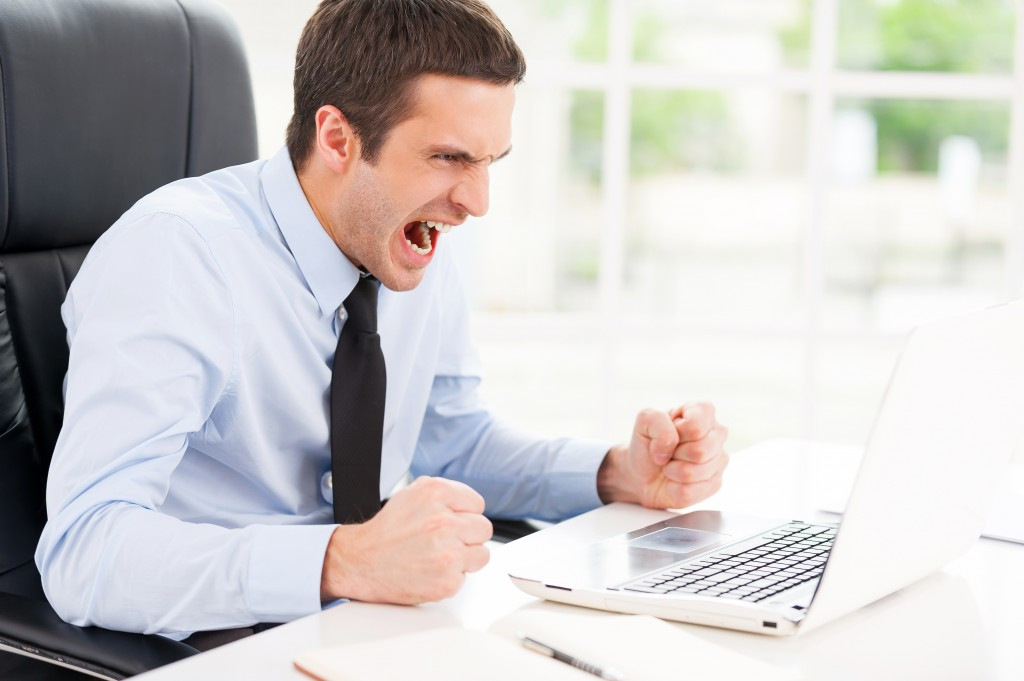 man angry with emotion and frustration