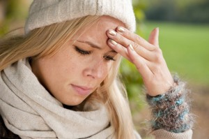 young teenaged woman with migraine or tension headache