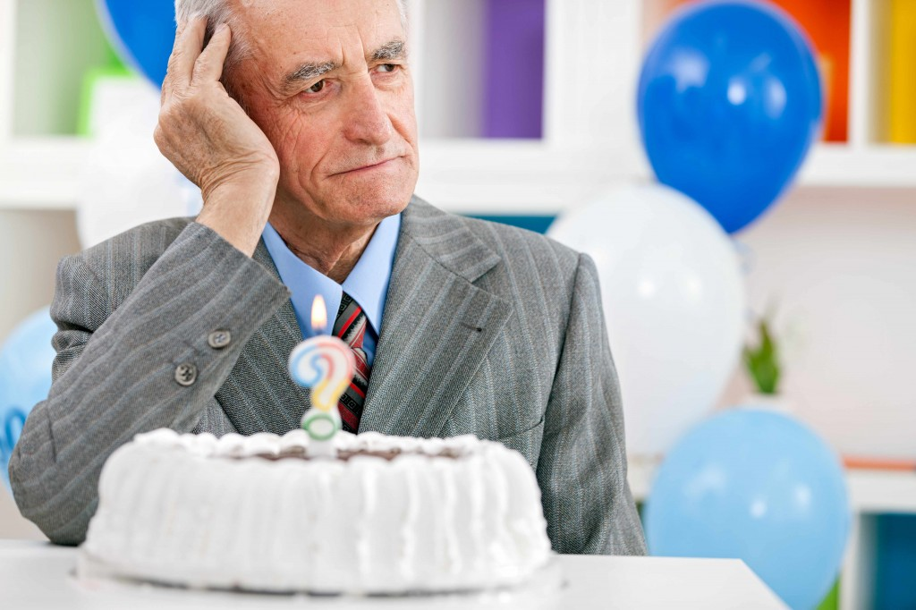 birthday cake and elderly man with Alzheimer's or dementia