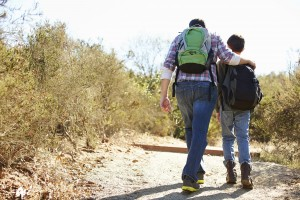 adult - parent walking with child having discussion