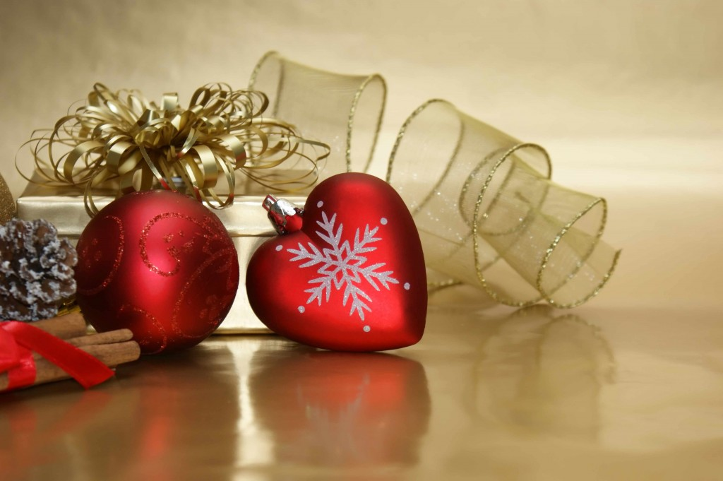holiday ribbon and tinsel with heart shaped ornament