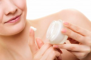 woman with skin creme for dry skin