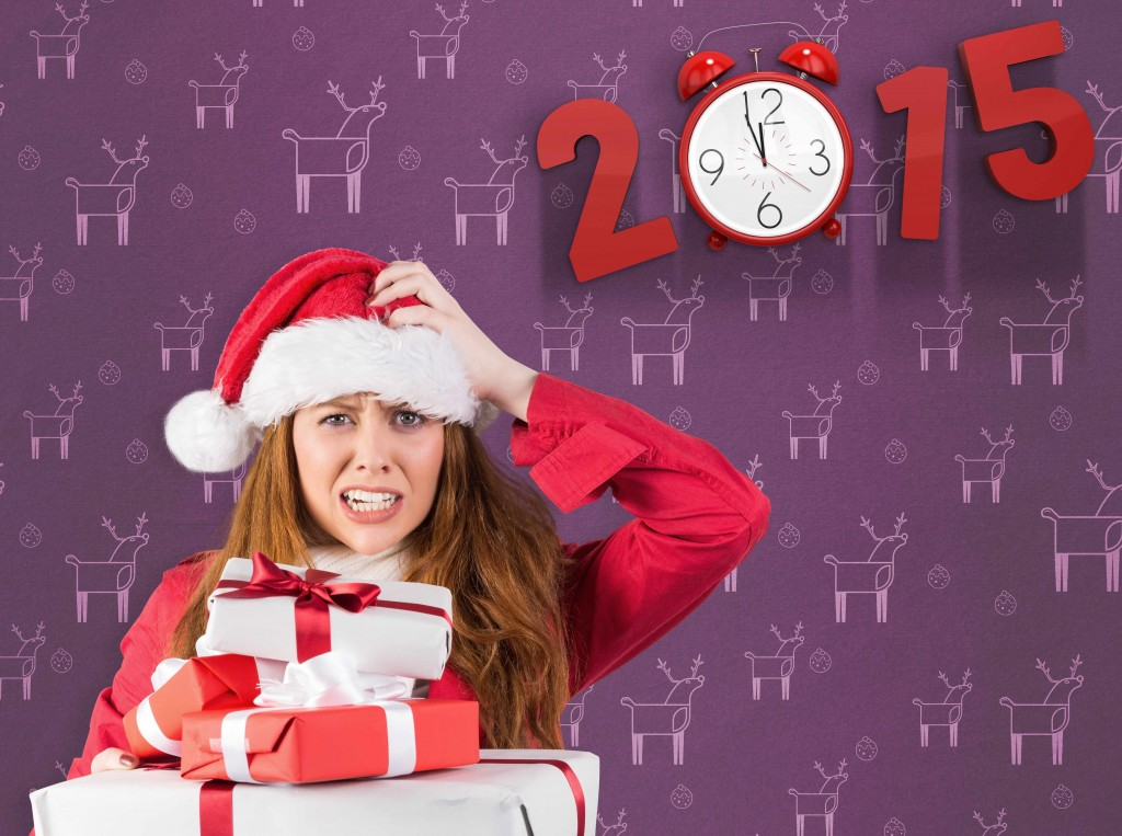 holiday stress with woman in santa hat and holding presents