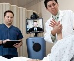 Physician and patient looking at telestroke machine