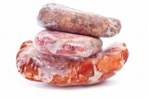 frozen meat wrapped in plastic