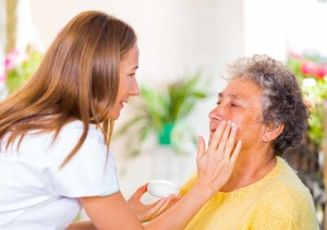 young nurse giving care to eldery person in hospital, hospice, palliative care