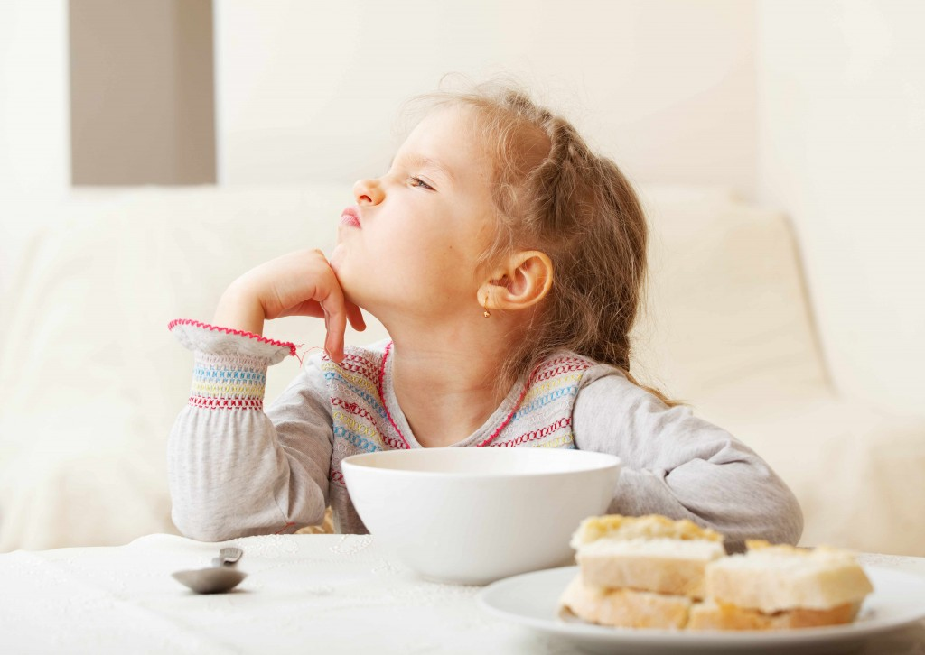 picky eater - child looking disgusted with food