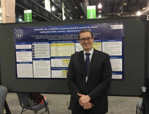 Dr. Kisiel at AACR meeting in front of his research poster