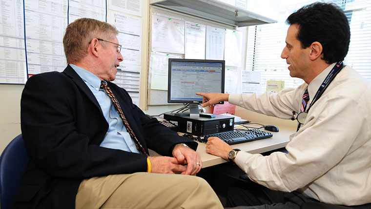 ePatient Dave talking with physician in doctor's office