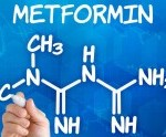Hand with pen drawing the chemical formula of metformin