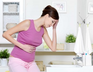 pregnant woman feeling sick with nausea, morning sickness