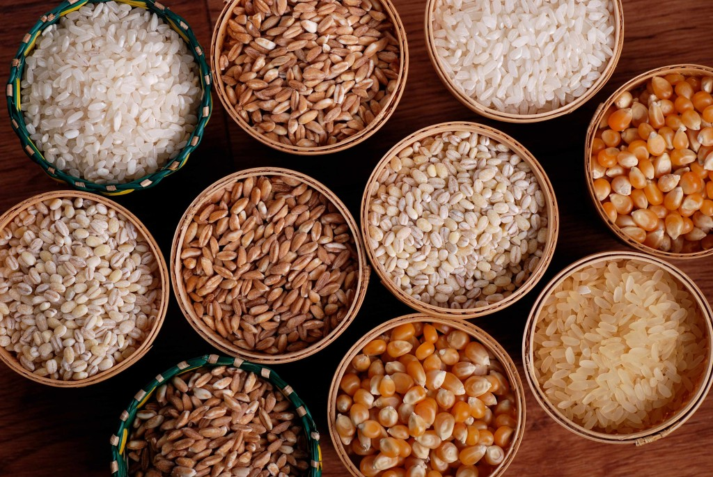 assorted nuts, grains and cereals in cups