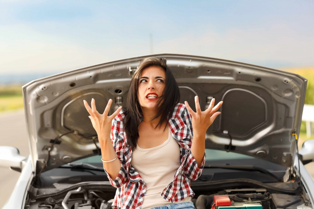 woman is upset, angry frustrated with car