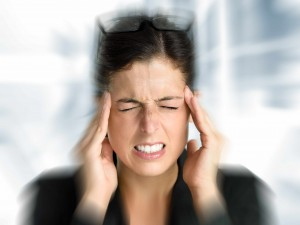 young woman with severe headache, migraine, stroke pain