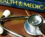 stethoscope and book binding with words health and medical, on table