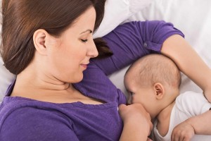 woman breast feeding, nursing baby