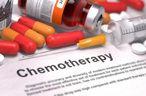 word chemotherapy on paper with pills and syringe, cancer
