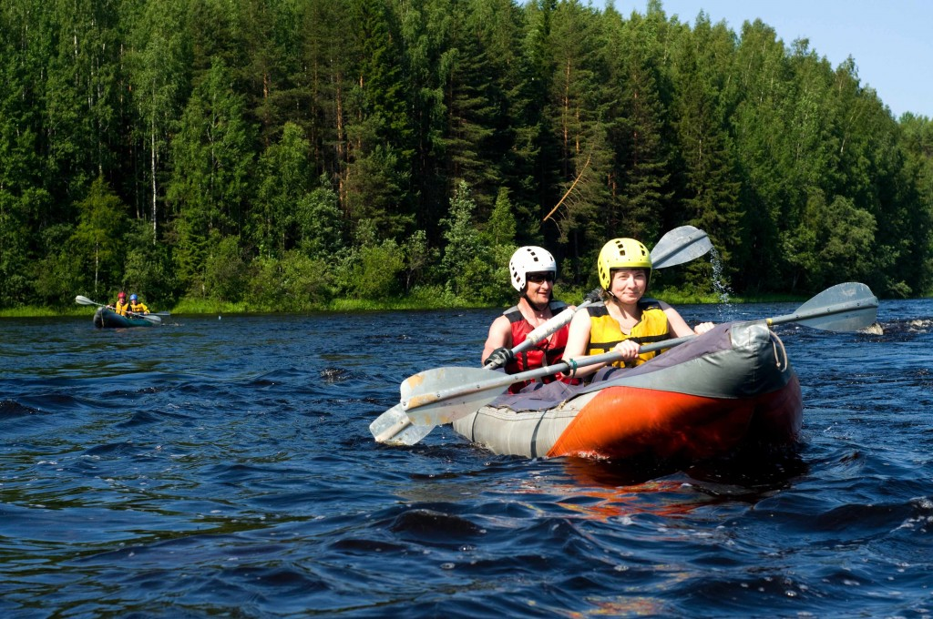 man and woman boating in a canoe on a lake, water safety