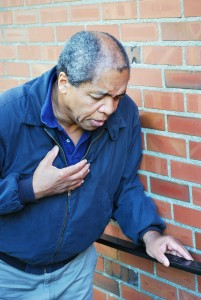 middle-aged man having chest pains, stroke symptoms