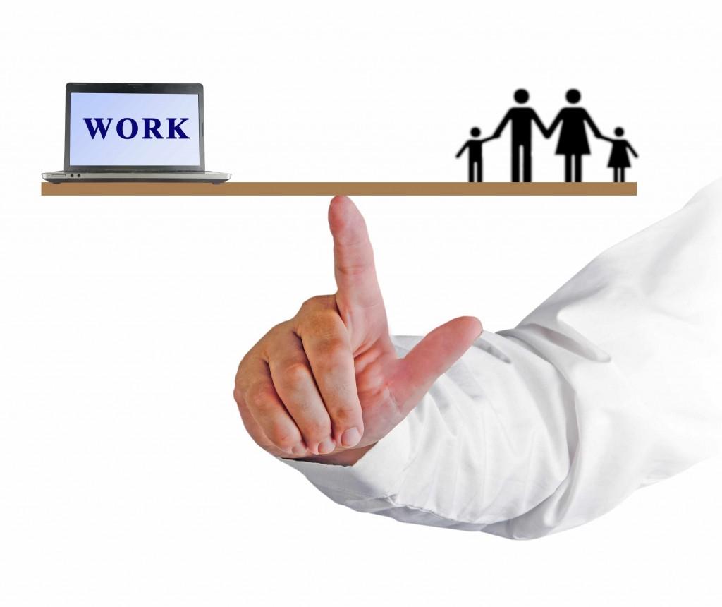 work-life balance image, man's hand balancing a scale
