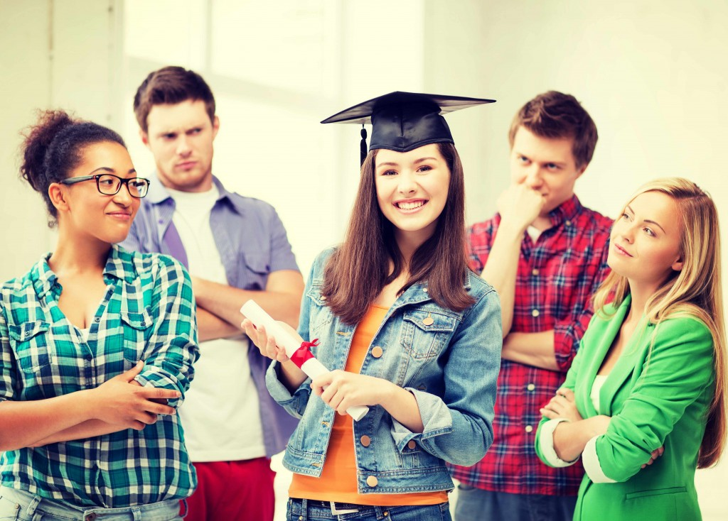 woman with school diploma and friends looking at her with envy or jealousy