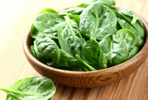 bowl of spinach lettuce leaves representing vitamin E