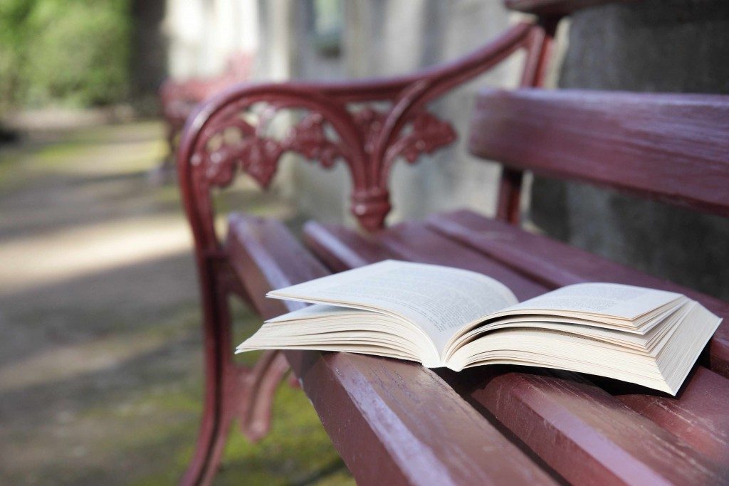 park bench with a open book