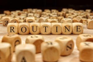 wood blocks spelling out the word routine