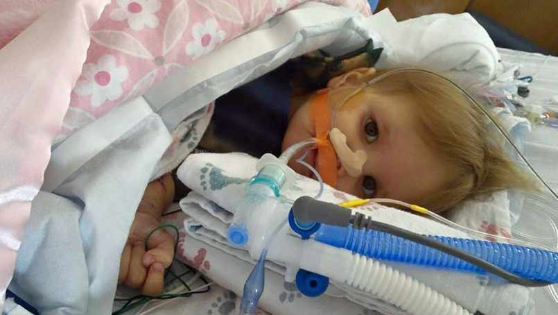 baby Aria in hospital bed with tubes