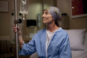 cancer patient in hospital with IV bag