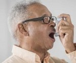 adult man using an inhaler for asthma