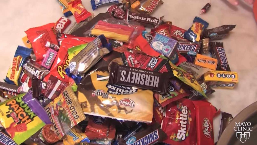 pile of candy and treats from Halloween