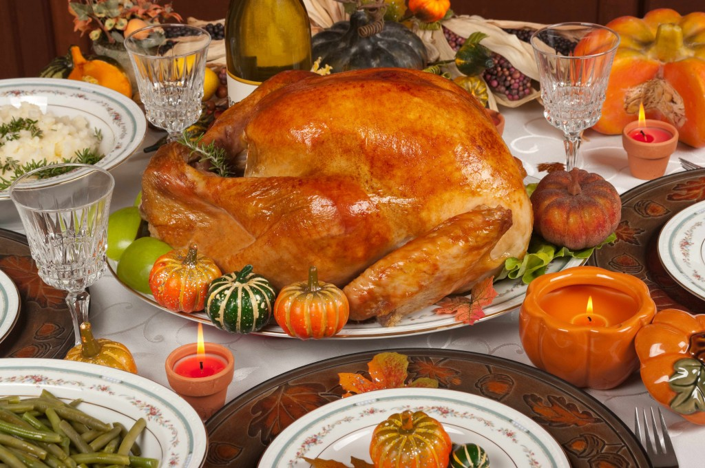table set for holiday dinner, turkey on table