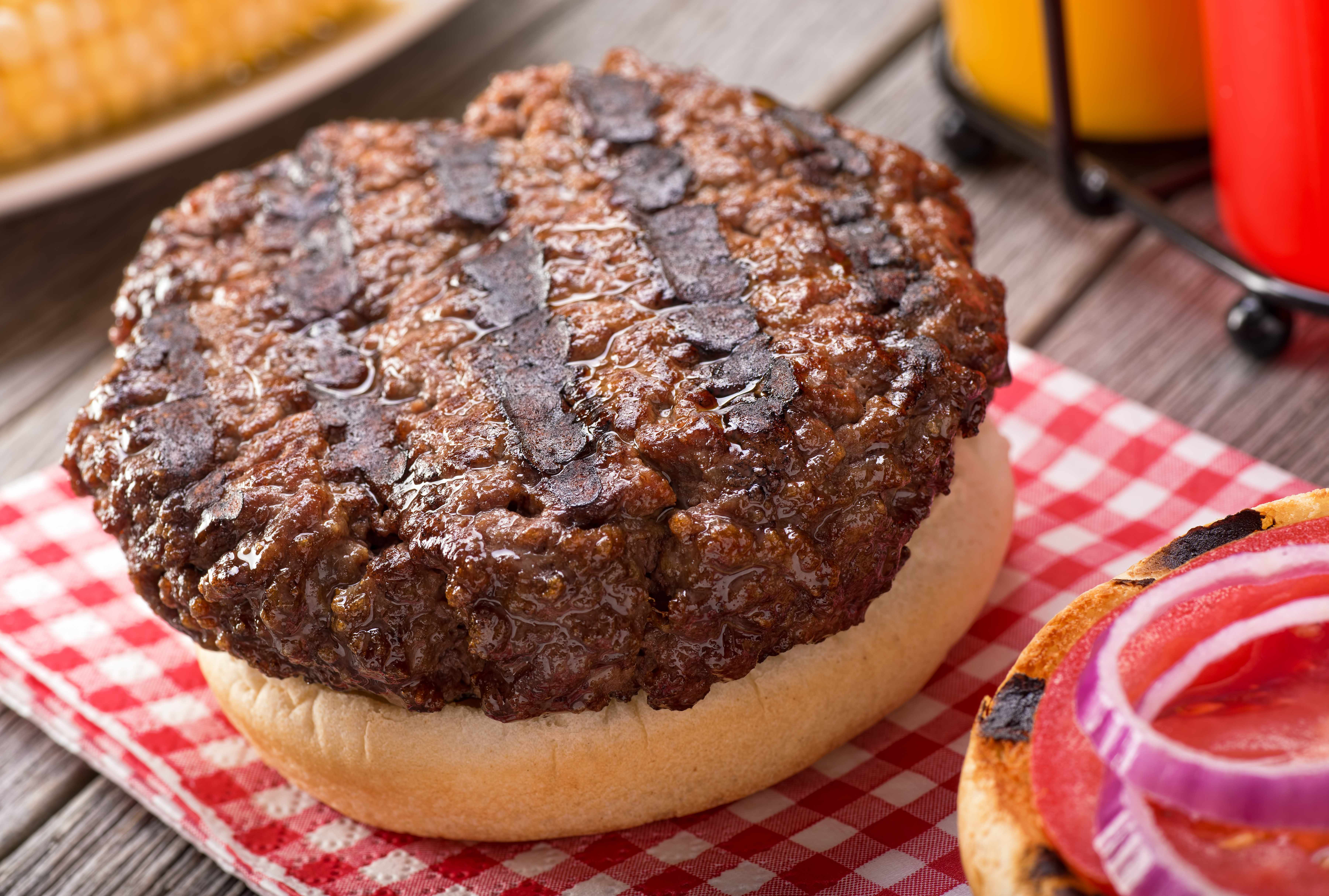 cooked hamburger patty on a bun