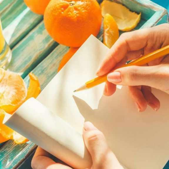 woman writing in food diary