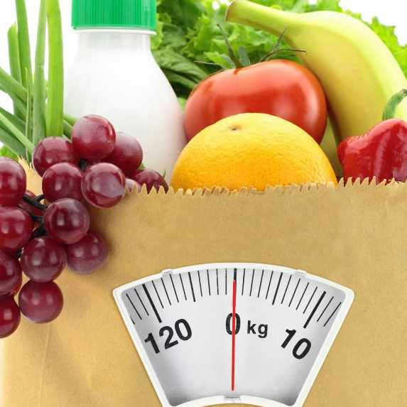 healthy food in grocery bag with scale