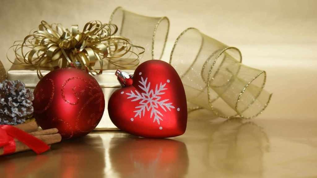 holiday ornaments, one shaped like a heart
