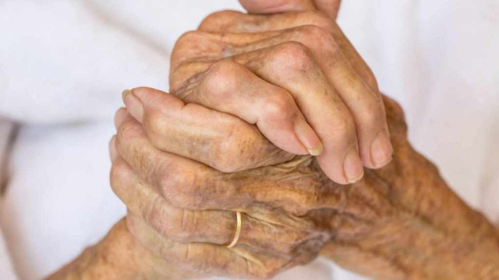 older person with age spots on hands